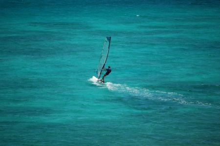 Windsurfer captured with zoom from our terrace.  I love this picture with the many shades of blue and green in the water.